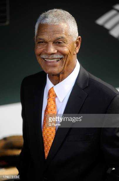 Felipe Alou talks with players before the game between the Boston Red Sox and the Baltimore Orioles at Oriole Park at Camden Yards on September 28...