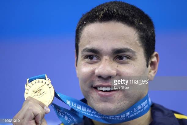 Felipe Alves Franca da Silva of Brazil poses with his gold medal after the Men's 50m Breaststroke Final during Day Twelve of the 14th FINA World...