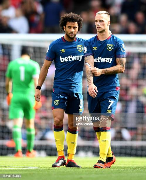 Felipe Anderson and Marko Arnautovic of West Ham United speak during the Premier League match between Arsenal FC and West Ham United at Emirates...
