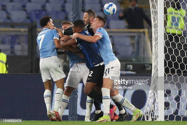 Felipe Anderson and Sergej Milinkovic-Savic of SS Lazio clash with Denzel Dumfries of FC Internazionale during the Serie A match between SS Lazio and...