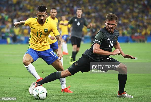 Felipe Anderson of Brazil and Grischa Proemel of Germany challenge for the ball during the Men's Football Final between Brazil and Germany at the...