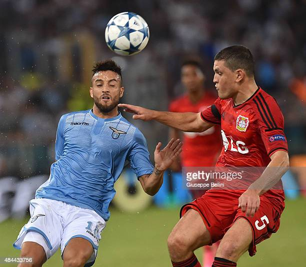 Felipe Anderson of SS Lazio and Kyriakos Papadopoulos of Bayer Leverkusen in action during the UEFA Champions League qualifying round play off first...
