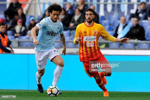 Felipe Anderson of SS Lazio compete for the ball with Danilo Cataldi of Benevento Calcio during the serie A match between SS Lazio and Benevento...