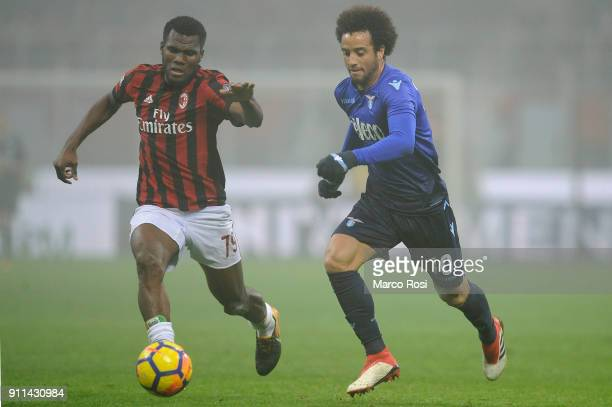 Felipe Anderson of SS Lazio compete for the ball with Frack Kessie of AC Milan during the serie A match between AC Milan and SS Lazio at Stadio...