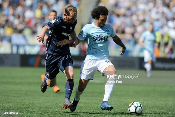 Felipe Anderson of SS Lazio compete for the ball with Ivan Strimic of UC Sampdoria during the serie A match between SS Lazio and UC Sampdoria at...