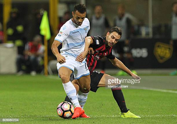 Felipe Anderson of SS Lazio competes for the ball Mattia De Sciglio of AC Milan during the Serie A match between AC Milan and SS Lazio at Stadio...