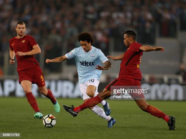 Felipe Anderson of SS Lazio competes for the ball with Juan jesus of AS Roma during the serie A match between SS Lazio and AS Roma at Stadio Olimpico...