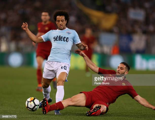 Felipe Anderson of SS Lazio competes for the ball with Kostas Manolas of AS Roma during the serie A match between SS Lazio and AS Roma at Stadio...