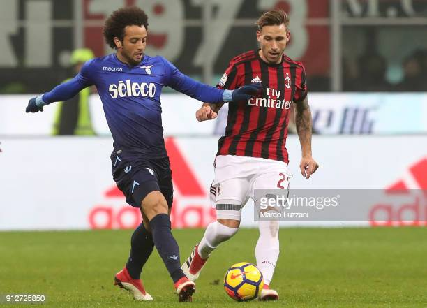 Felipe Anderson of SS Lazio competes for the ball with Lucas Biglia of AC Milan during the TIM Cup match between AC Milan and SS Lazio at Stadio...