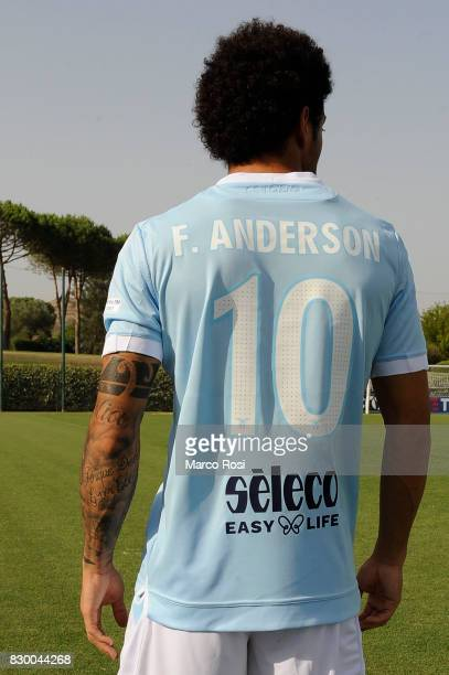 Felipe Anderson of SS Lazio wears the new SS Lazio shirt during the unveiling of the new shirt for the Italian Supercup Final on August 11 2017 in...