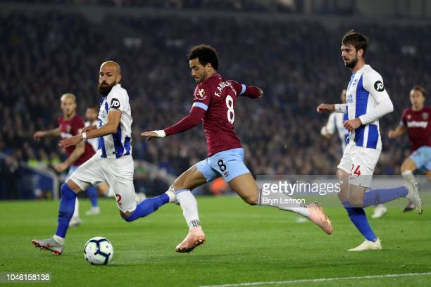 Felipe Anderson of West Ham United battles for possession with Bruno Saltor Grau of Brighton and Hove Albion during the Premier League match between...