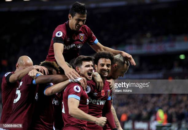 Felipe Anderson of West Ham United celebrates after scoring his team's third goal with his team mates during the Premier League match between West...