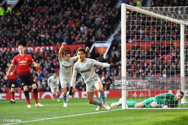 Felipe Anderson of West Ham United celebrates after scoring his team's first goal as David De Gea of Manchester United and Phil Jones of Manchester...