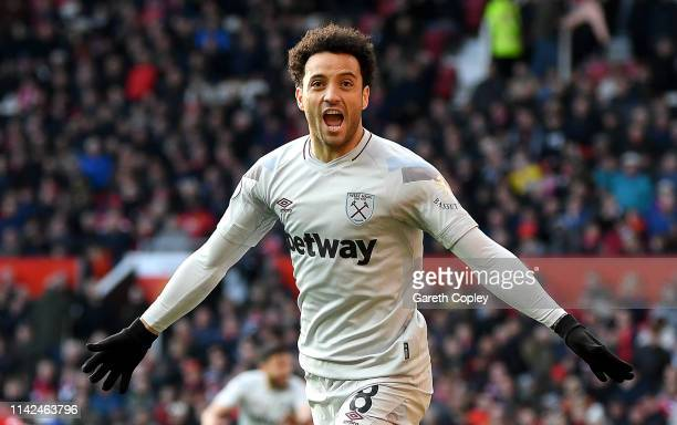 Felipe Anderson of West Ham United celebrates after scoring his team's first goal during the Premier League match between Manchester United and West...