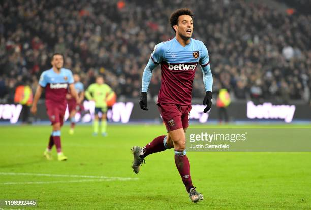 Felipe Anderson of West Ham United celebrates after scoring his team's fourth goal during the Premier League match between West Ham United and AFC...