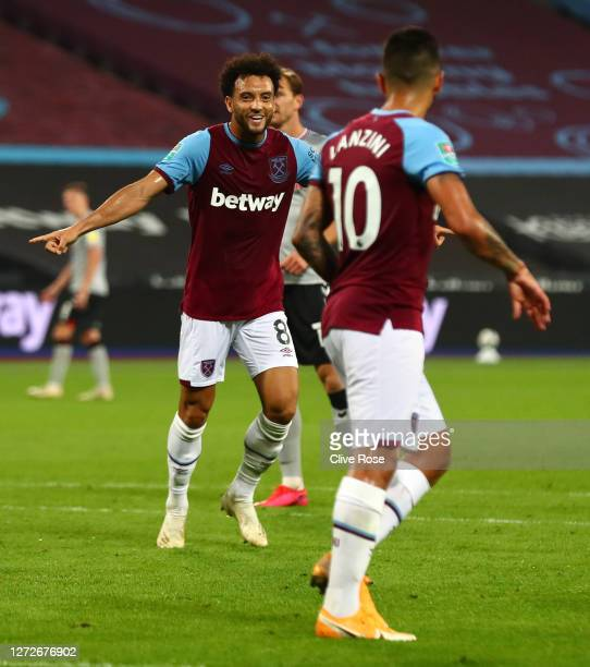 Felipe Anderson of West Ham United celebrates after scoring his team's third goal during the Carabao Cup Second Round Match between West Ham United...