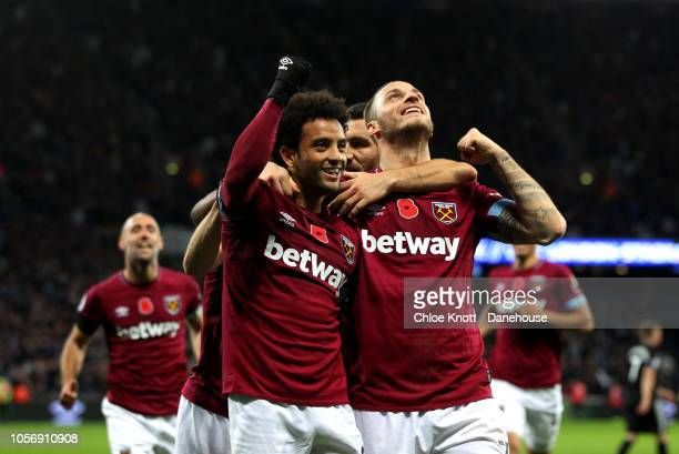 Felipe Anderson of West Ham United celebrates scoring his teams third goal during the Premier League match between West Ham United and Burnley FC at...