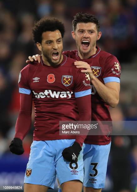 Felipe Anderson of West Ham United celebrates scoring the equalising goal with Aaron Cresswell during the Premier League match between Huddersfield...