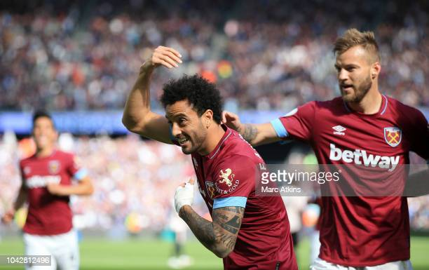 Felipe Anderson of West Ham United celebrates with Andriy Yarmolenko after scoring the opening goal during the Premier League match between West Ham...
