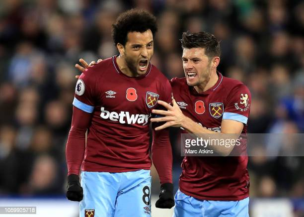 Felipe Anderson of West Ham United celebrates with teammate Aaron Cresswell after scoring his team's first goal during the Premier League match...