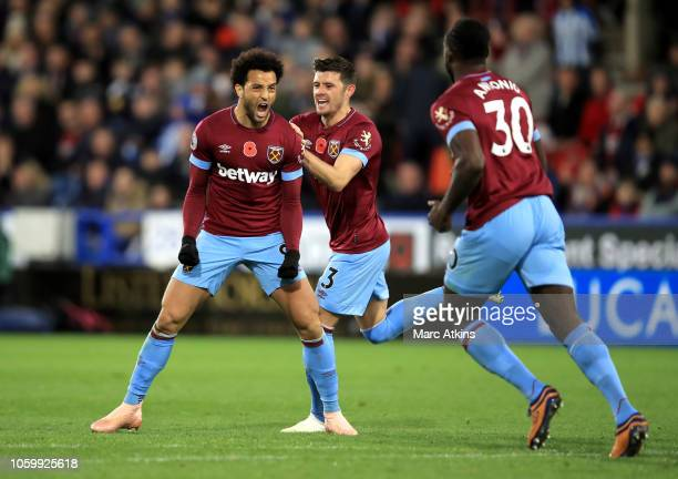 Felipe Anderson of West Ham United celebrates with teammates after scoring his team's first goal during the Premier League match between Huddersfield...