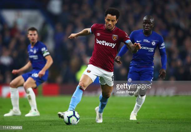 Felipe Anderson of West Ham United evades N'golo Kante of Chelsea during the Premier League match between Chelsea FC and West Ham United at Stamford...