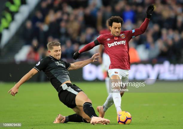Felipe Anderson of West Ham United is challenged by James Tarkowski of Burnley during the Premier League match between West Ham United and Burnley FC...
