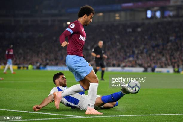 Felipe Anderson of West Ham United is tackled by Alireza Jahanbakhsh of Brighton and Hove Albion during the Premier League match between Brighton...