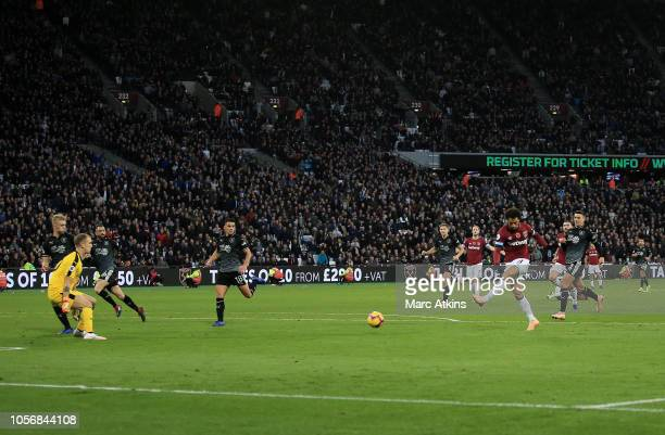 Felipe Anderson of West Ham United scores his team's second goal during the Premier League match between West Ham United and Burnley FC at London...
