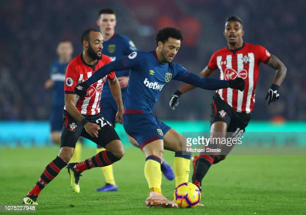Felipe Anderson of West Ham United shoots as Nathan Redmond of Southampton and Mario Lemina of Southampton looks on during the Premier League match...