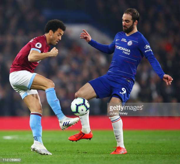 Felipe Anderson of West Ham United takes on Gonzalo Higuain of Chelsea during the Premier League match between Chelsea FC and West Ham United at...