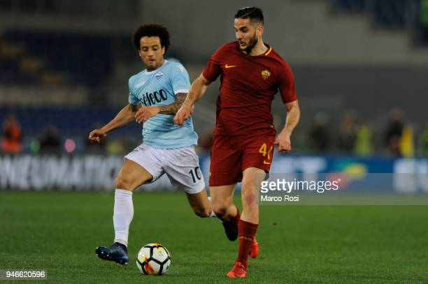 Felipe Anderson Ramos of SS Lazio compete for the ball with Kostas Manolas AS Roma during the serie A match between SS Lazio and AS Roma at Stadio...