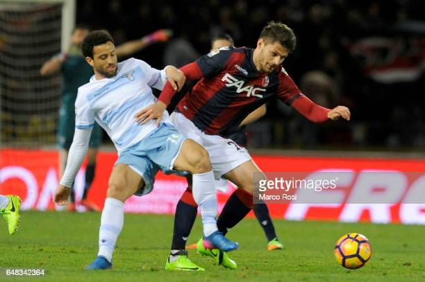 Felipe Andersonj of SS Lazio compete for the ball with Adam Nagy of Bologna FC during the Serie A match between Bologna FC and SS Lazio at Stadio...