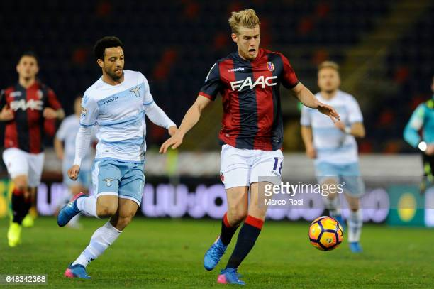 Felipe Andersonj of SS Lazio compete for the ball with Filip Helander of Bologna FC during the Serie A match between Bologna FC and SS Lazio at...