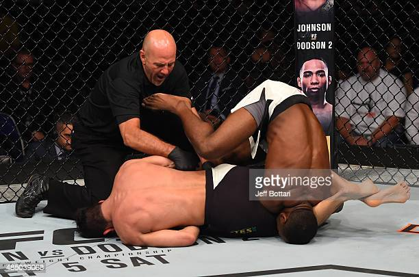 Felipe Arantes of Brazil secures an arm bar submission against Yves Jabouin in their bantamweight bout during the UFC event at the SaskTel Centre on...