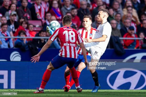 Felipe Augusto de Almeida of Atletico de Madrid Saul Niguez of Atletico de Madrid and Lucas Ocampos of Sevilla FC battle for the ball during the Liga...