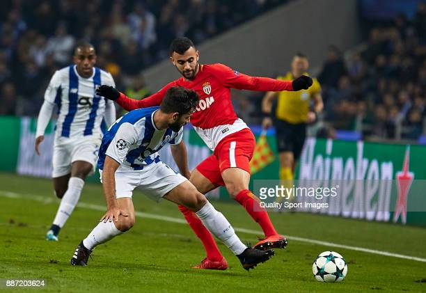 Felipe Augusto de Almeida of FC Porto competes for the ball with Rachid Ghezzal of AS Monaco during the UEFA Champions League group G match between...