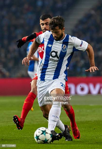 Felipe Augusto de Almeida of FC Porto is challenged by Rachid Ghezzal of AS Monaco during the UEFA Champions League group G match between FC Porto...