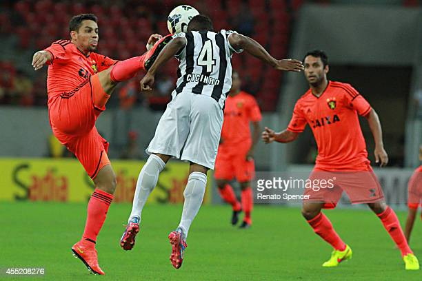 Felipe Azevedo of Sport Recife battles for the ball with Cicinho of Santos during the Brasileirao Series A 2014 match between Sport Recife and Santos...