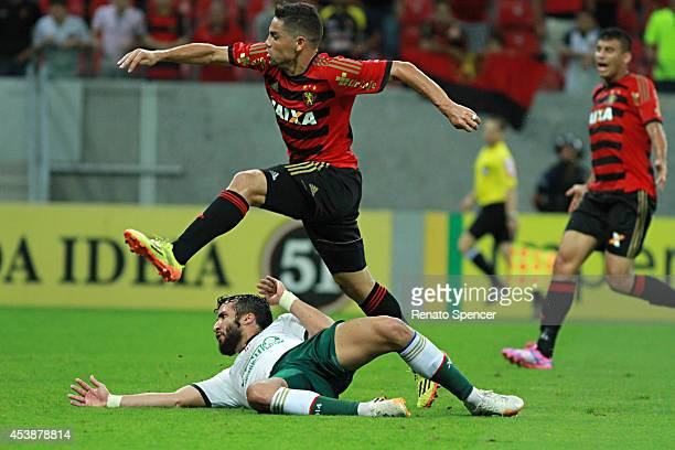 Felipe Azevedo of Sport Recife battles for the ball with Victorino of Palmeiras during the Brasileirao Series A 2014 match between Sport Recife and...