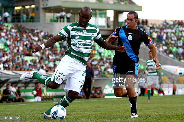 Felipe Baloy of Santos struggles for the ball with Aaron Padilla of Puebla during a match as part of the Clausura 2011 at Corona Stadium on April 13...