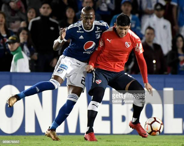 Felipe Banguero of Millonarios vies for the ball with Alan Franco of Independiente during a match between Millonarios and Independiente as part of...