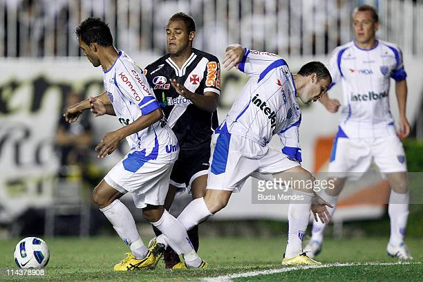 Felipe Bastos of Vasco struggles for the ball with a players of Avai during a match as part of Brazil Cup 2011 at Sao Januario stadium on May 18 2011...