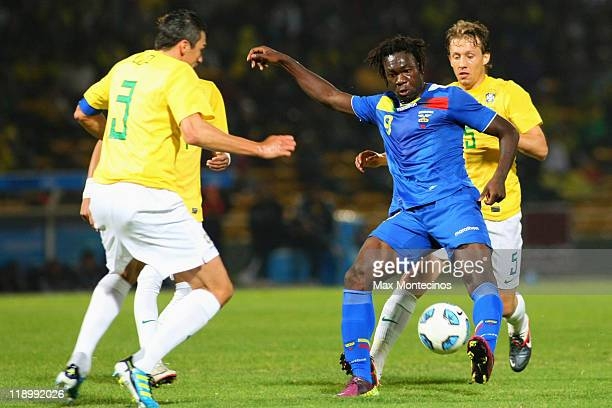Felipe Caicedo , from Ecuador, fights for the ball with Lúcio, from Brazil, during a match between Brazil and Ecuador as part of the Group B of the...