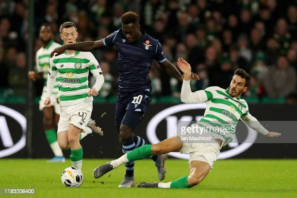 Felipe Caicedo of Lazio is tackled by Hatem Elhamed of Celtic during the UEFA Europa League group E match between Celtic FC and Lazio Roma at Celtic...