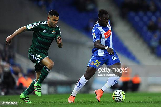 Felipe Caicedo of RCD Espanyol competes for the ball with Bruno Gonzalez Real Betis Balompie during the La Liga match between Real CD Espanyol and...