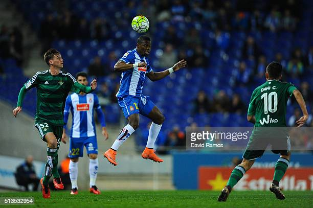 Felipe Caicedo of RCD Espanyol competes for the ball with Fabian of Real Betis Balompie during the La Liga match between Real CD Espanyol and Real...