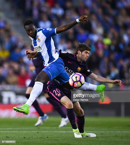 Felipe Caicedo of RCD Espanyol competes for the ball with Sergi Roberto of FC Barcelona during the La Liga match between RCD Espanyol and FC...
