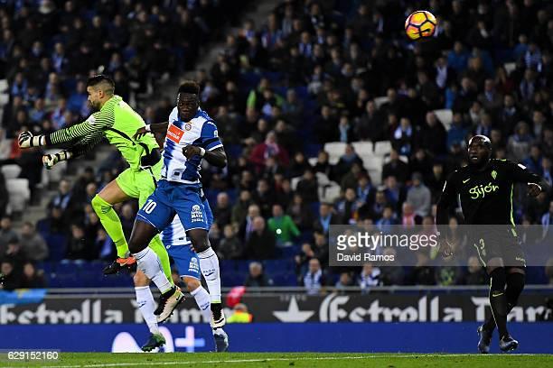 Felipe Caicedo of RCD Espanyol scores the opening goal past Ivan Cuellar of Real Sporting de Gijon during the La Liga match between RCD Espanyol and...