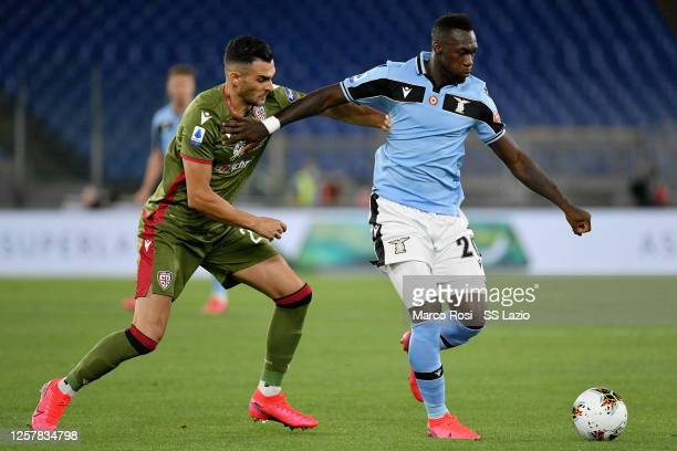 Felipe Caicedo of SS Lazio compete for the ball with Charalampos Lykogiannis of Cagliari Calcio during the Serie A match between SS Lazio and...